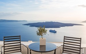 Luxury suites Sea view balcony with furniture from Cosmopolitan Suites Santorini double room in Fira